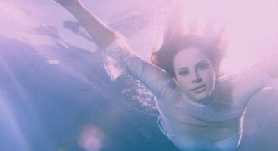 Lana Del Rey Drinks The Kool-Aid In Cult Video For 'Freak'